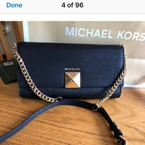 Michael Kors clutch with shoulder strap